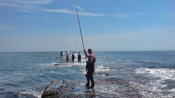 fishermen on Filey Brigg