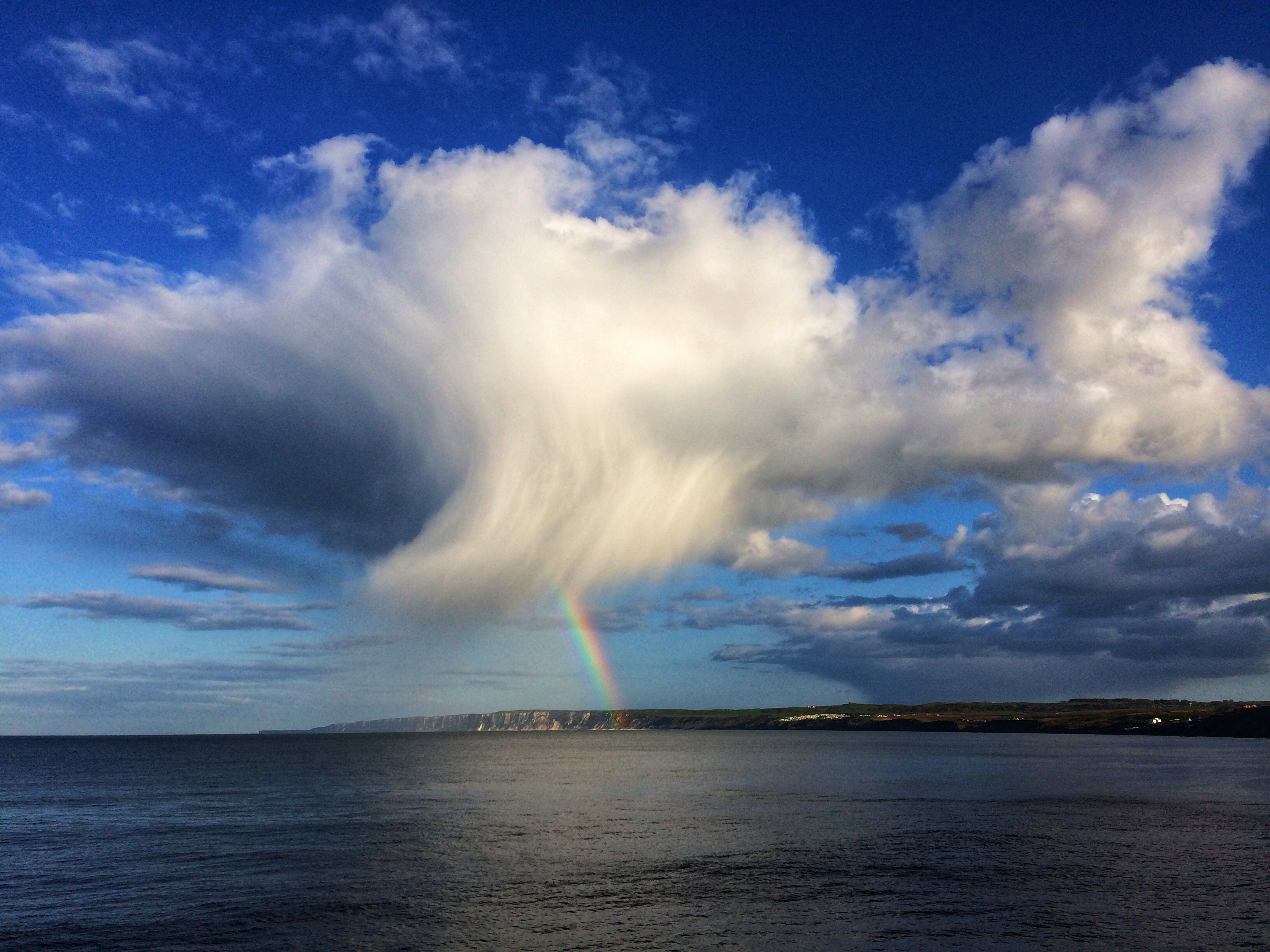 'Fish' cloud and rainbow over Bempton
