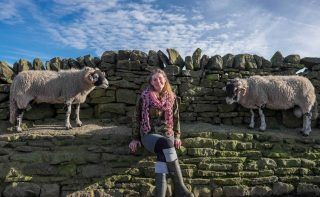 Amanda Owen, with sheep
