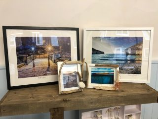 Framed photographs of Filey in shop window