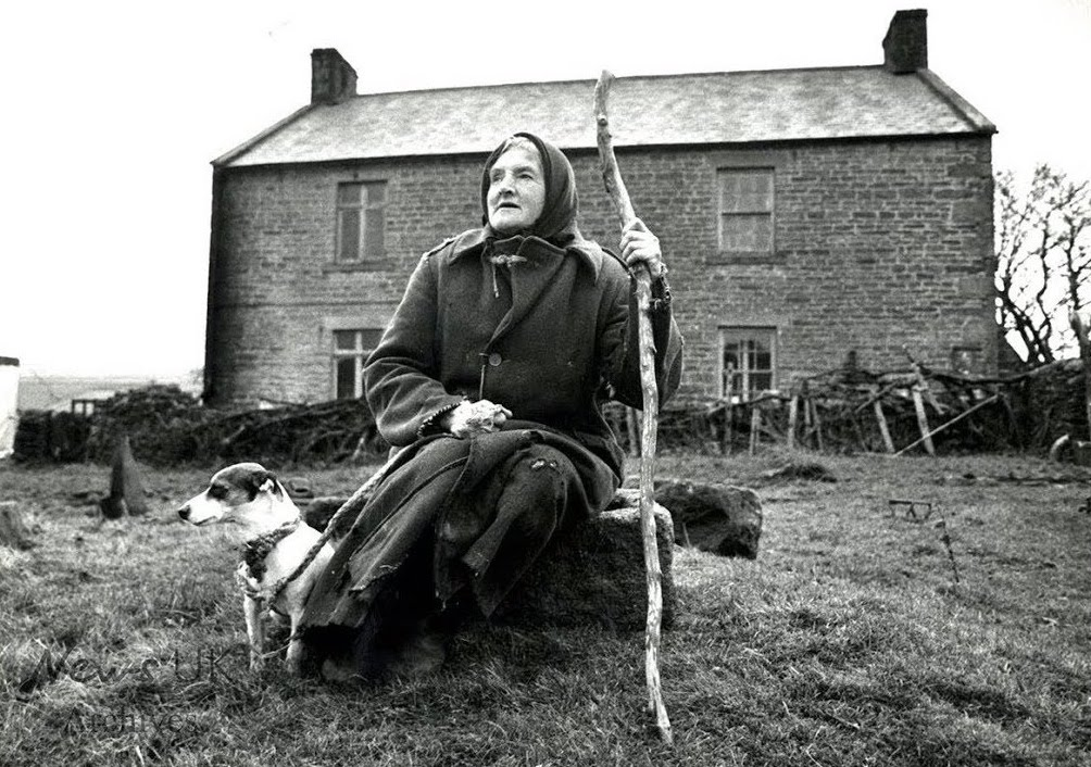 Hannah Hauxwell with dog in front of her Dales farm house