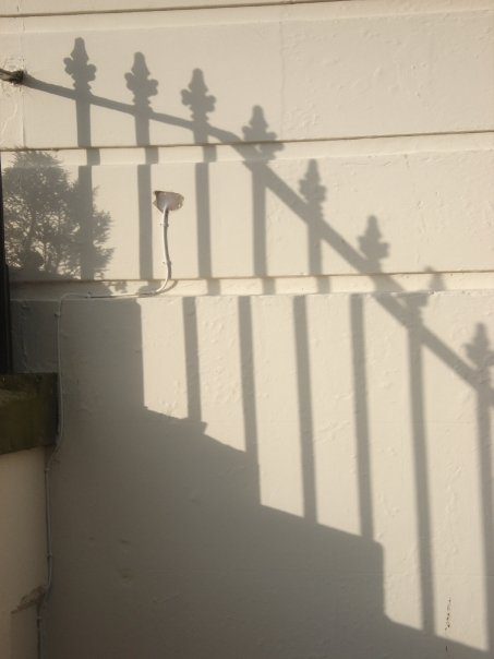 shadow of ironwork on The Crescent